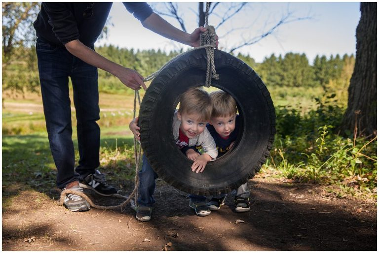 playing on a tire swing during family photos